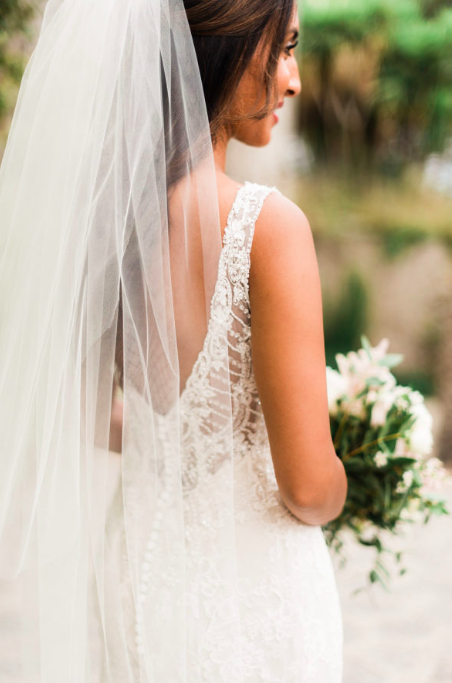 Ishra, decided on our fitted Ivory Chantilly Lace Rosa Clara Acuraio gown with light beading around the bodice and sheer delicate detailing on the open back. Her gown couldn't suit this Romantic venue more.