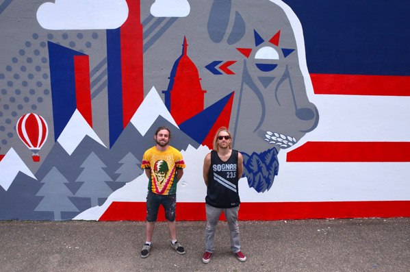 Close up of the artists in front of the Budweiser Mural