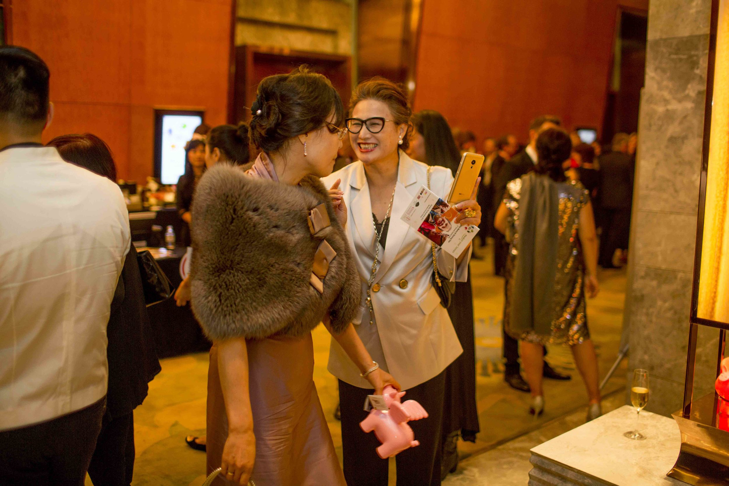 Wu Ching Ju delighted after the successful auction of one of her works - another operation made possible.