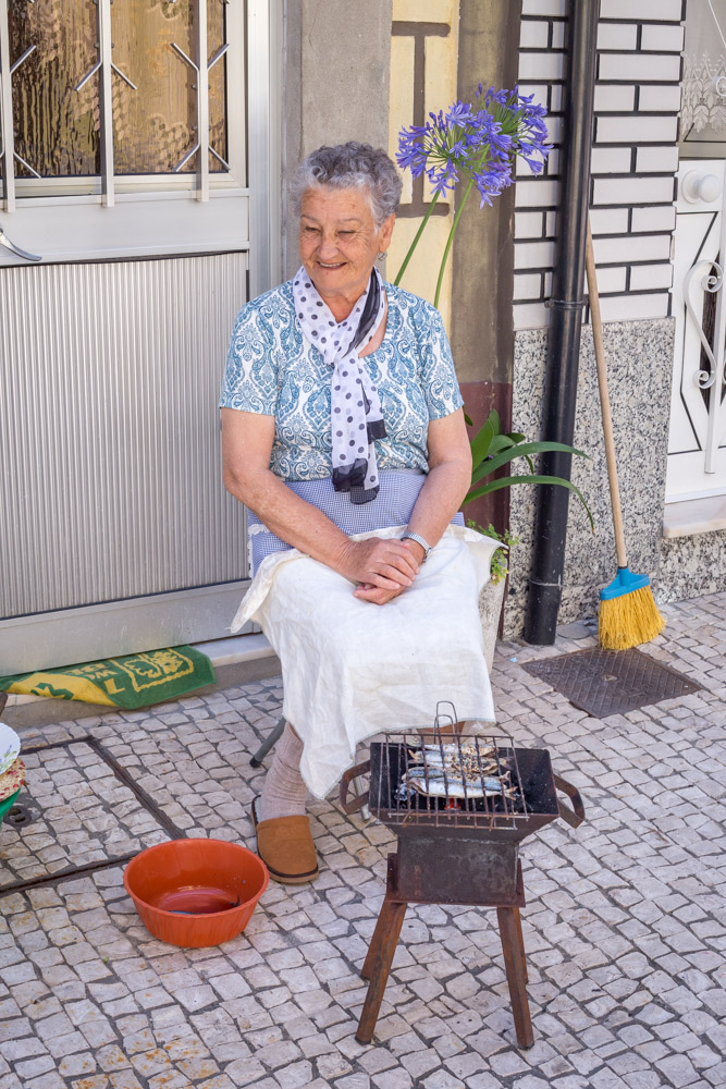 Granny making herself some grilled sardines for lunch.
