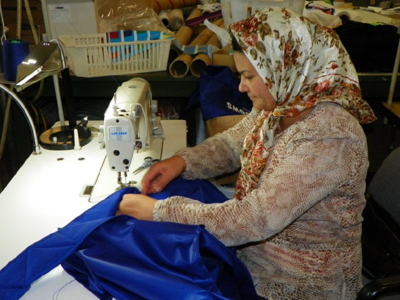 Common Thread is a   social enterprise  that sources street banners and other fabric to convert into colourful and durable products. Above is a photo of the  Hope in the Shadows  bag production.