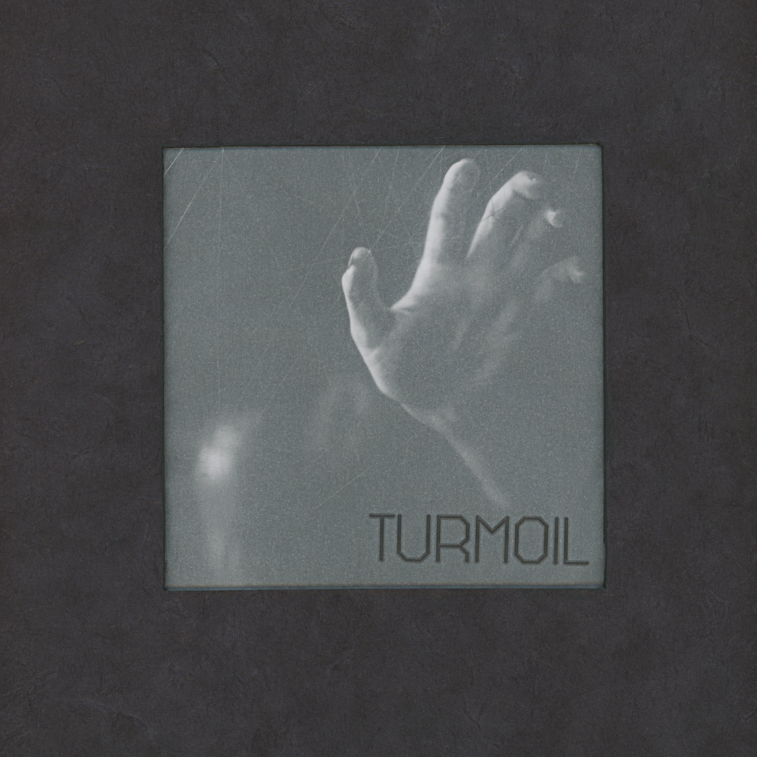 "A Handmade book created to display images from my ""Turmoil"" series along side poetry."