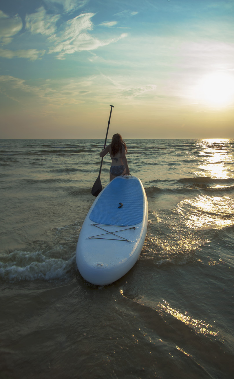 Woman and paddleboard