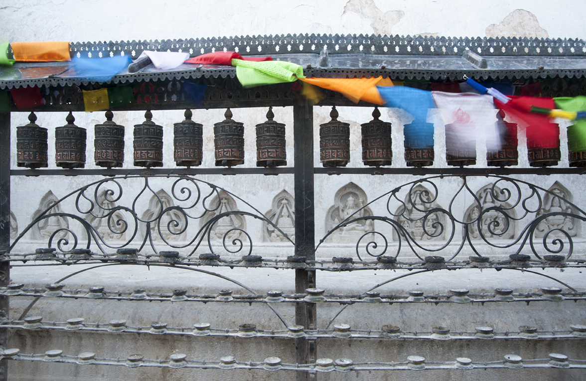Prayer flags and prayer wheels at Swayambhunath Temple, also known as the Monkey Temple, Kathmandu, Nepal