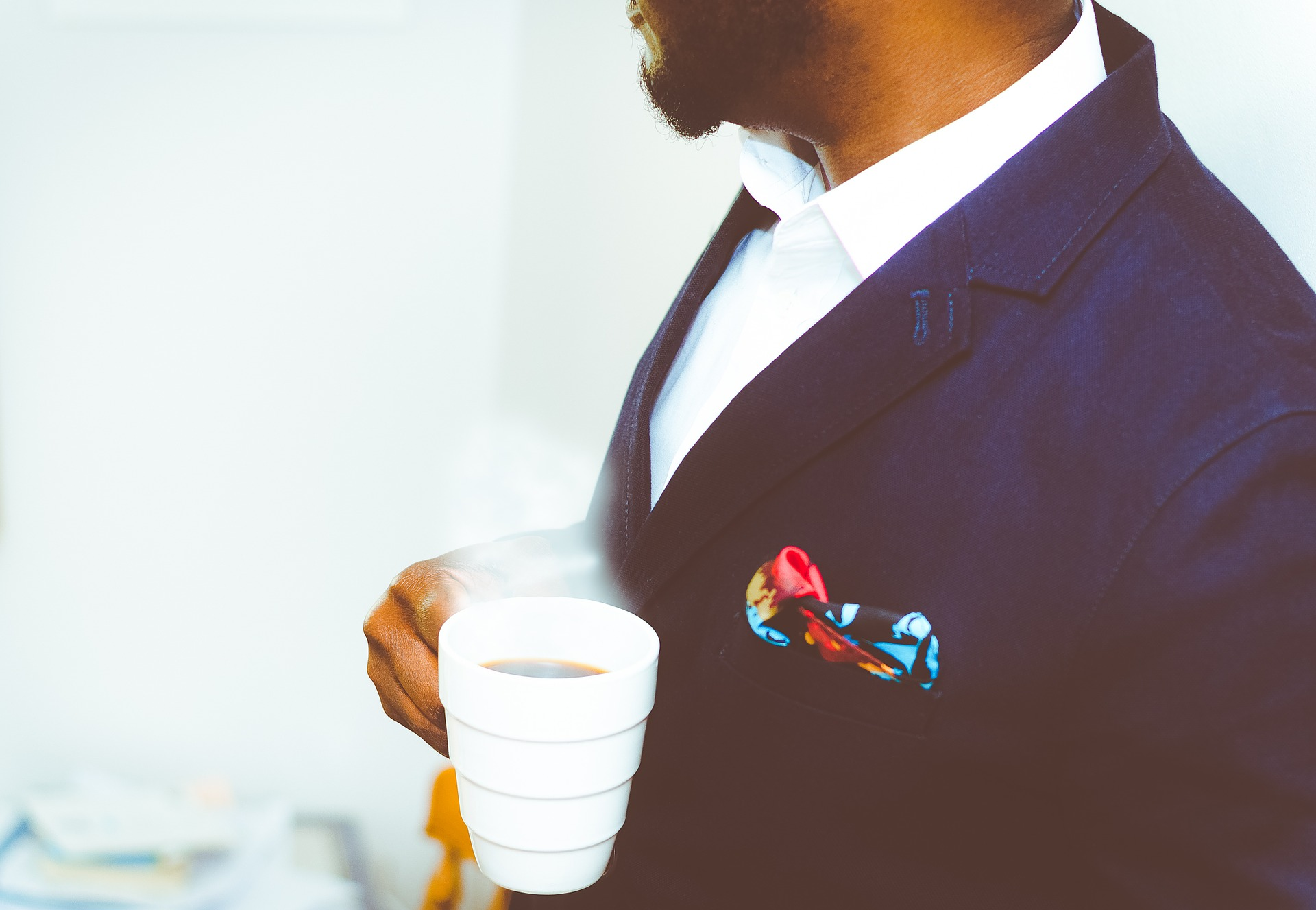 business leader holding cofee