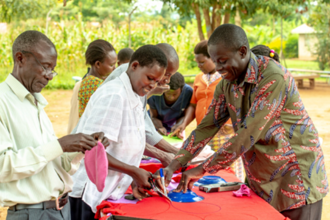 Community members make reusable sanitary pads together.