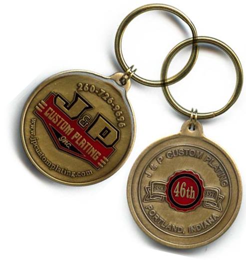Custom J&P Keychains produced  b y  T  he Falcon Mint