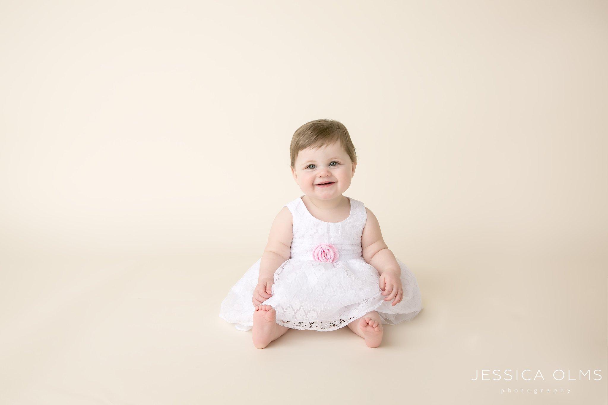 9 month in white dress columbus ohio baby photographer