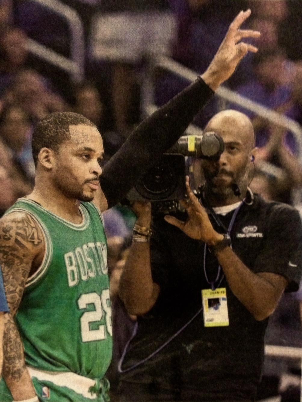 Clem Harrod, Sports Videographer  (right)  filming Jameer Nelson, Boston Celtics Point Guard  (left)