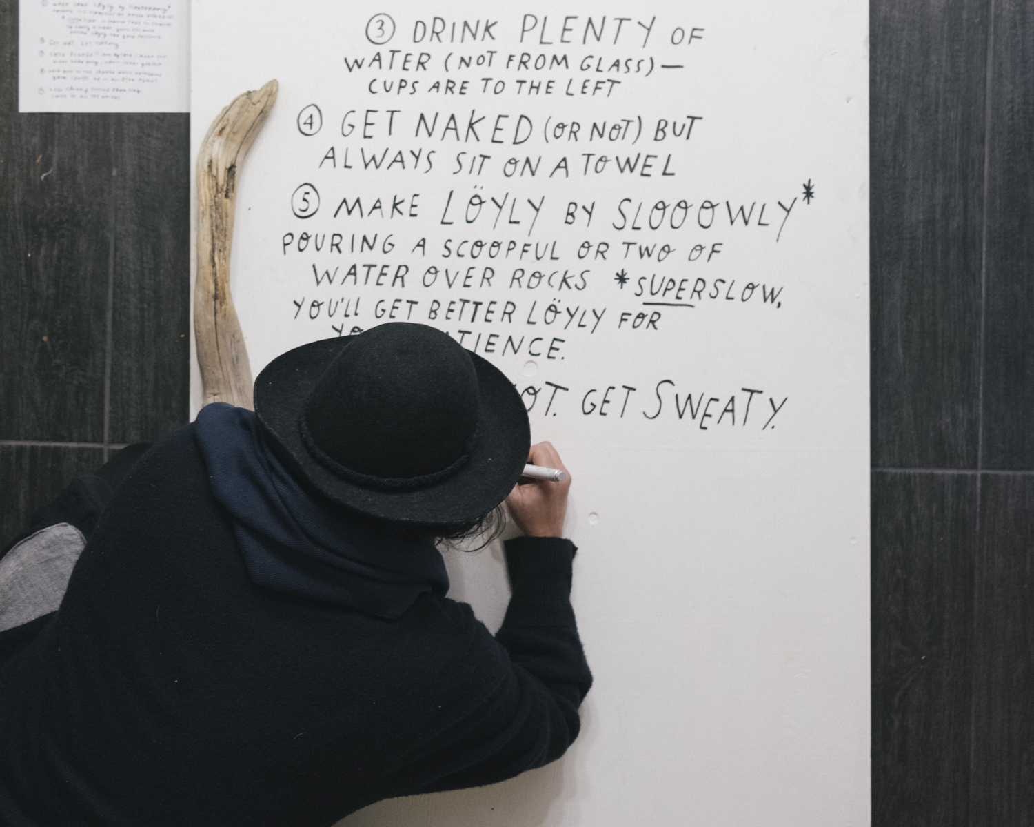 Mary Rothlisberger  illustrating The Jennings Hotel sauna guide during her 54 hour residency