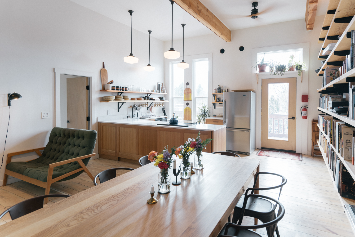 The bright, well equipped kitchen and dining room, with books to enjoy and access to our balcony