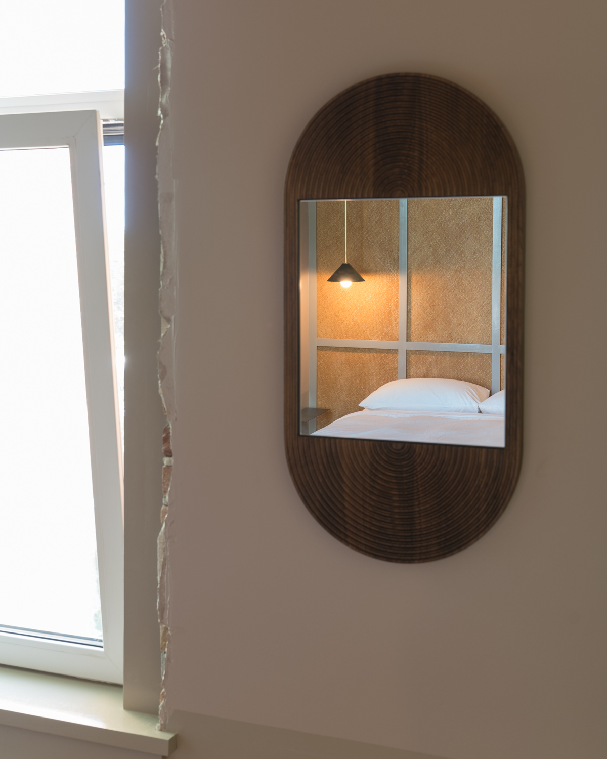 A  June mirror  by By  Coil + Drift  in room 1