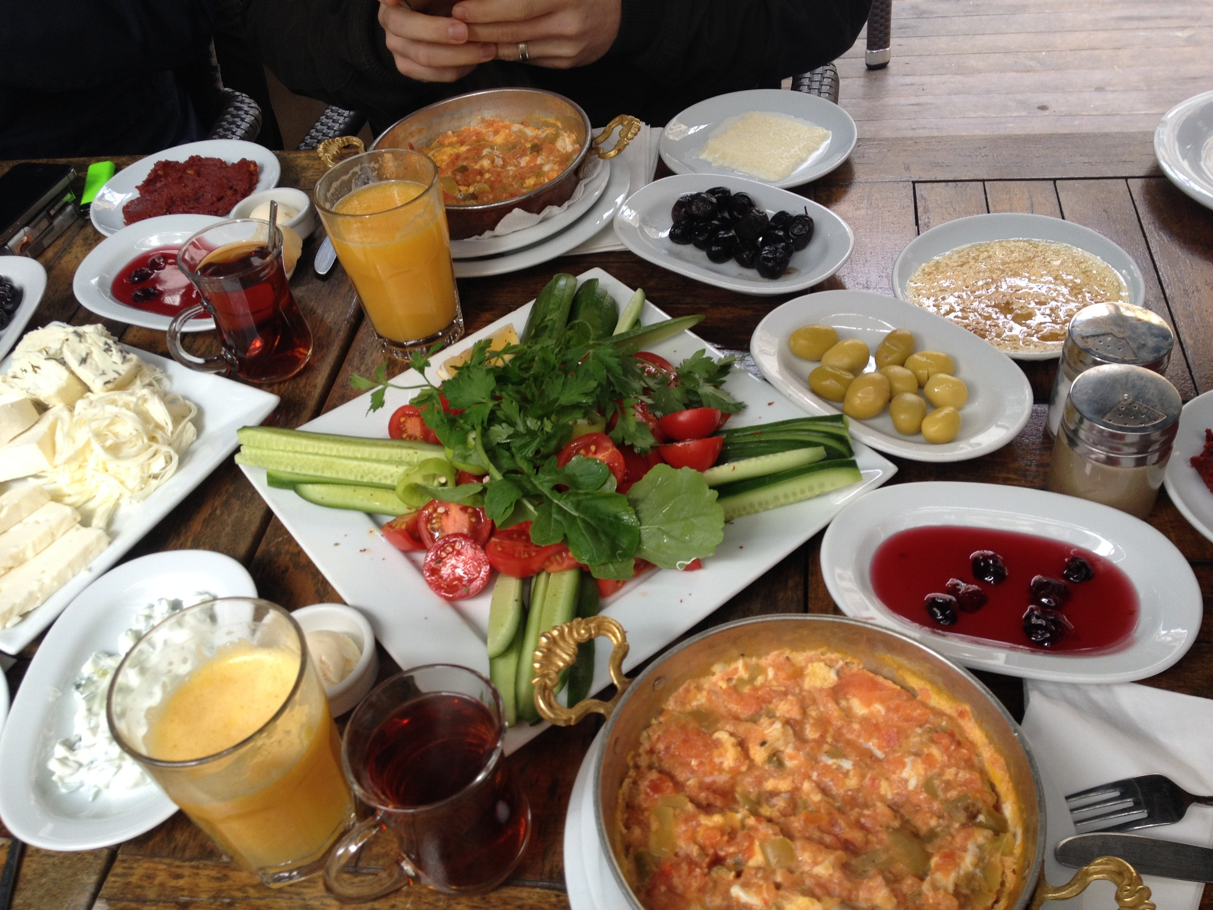 Traditional breakfast with freshly cut tomatoes and cucumbers, freshly squeezed orange juice, variety of cheeses, scrambled egg (menemen) and various other goodies.