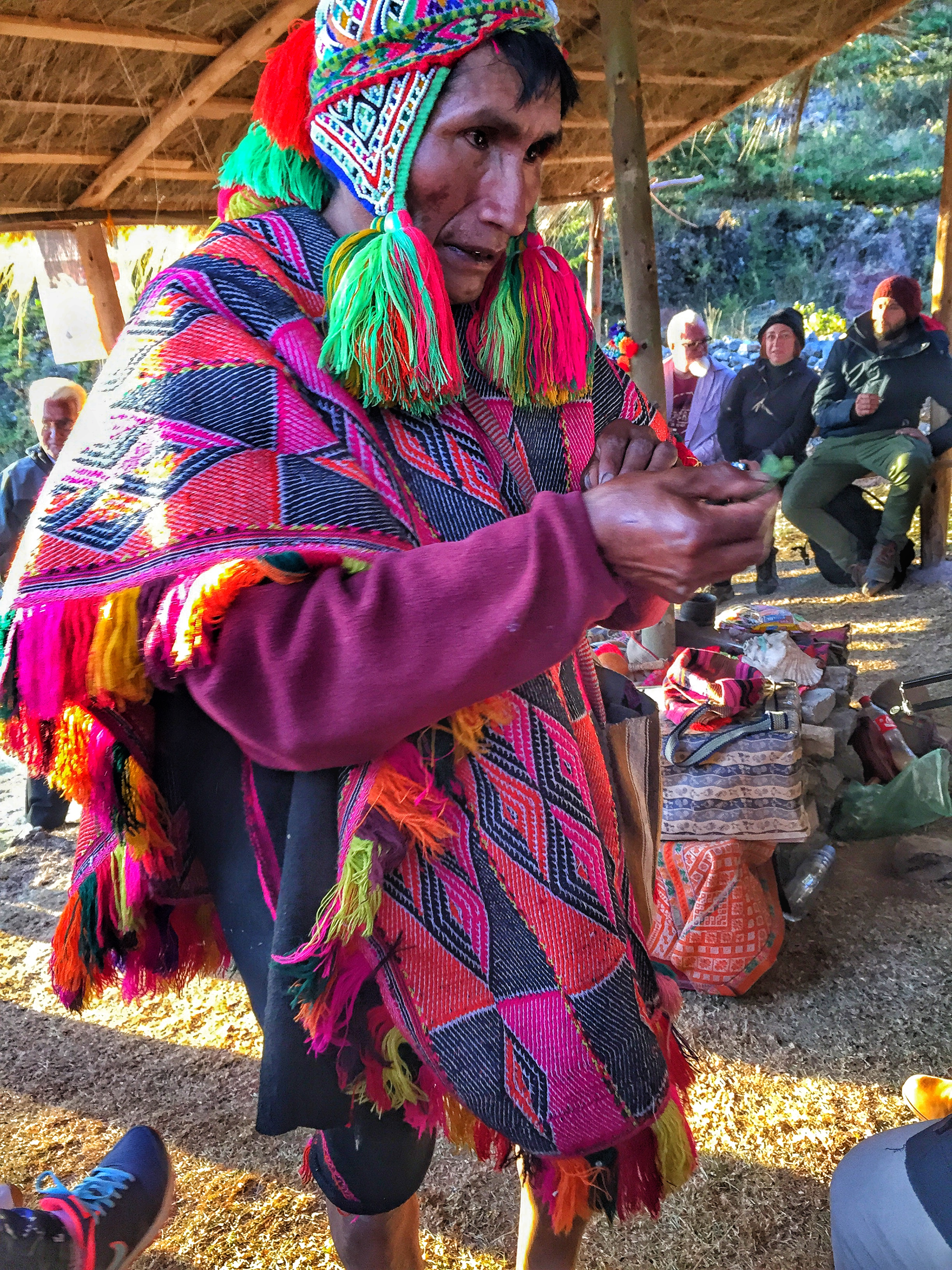 A Quechuan Priest offering prayers to the spirits. The Quechuan people revere Pachamama, Mother Earth.
