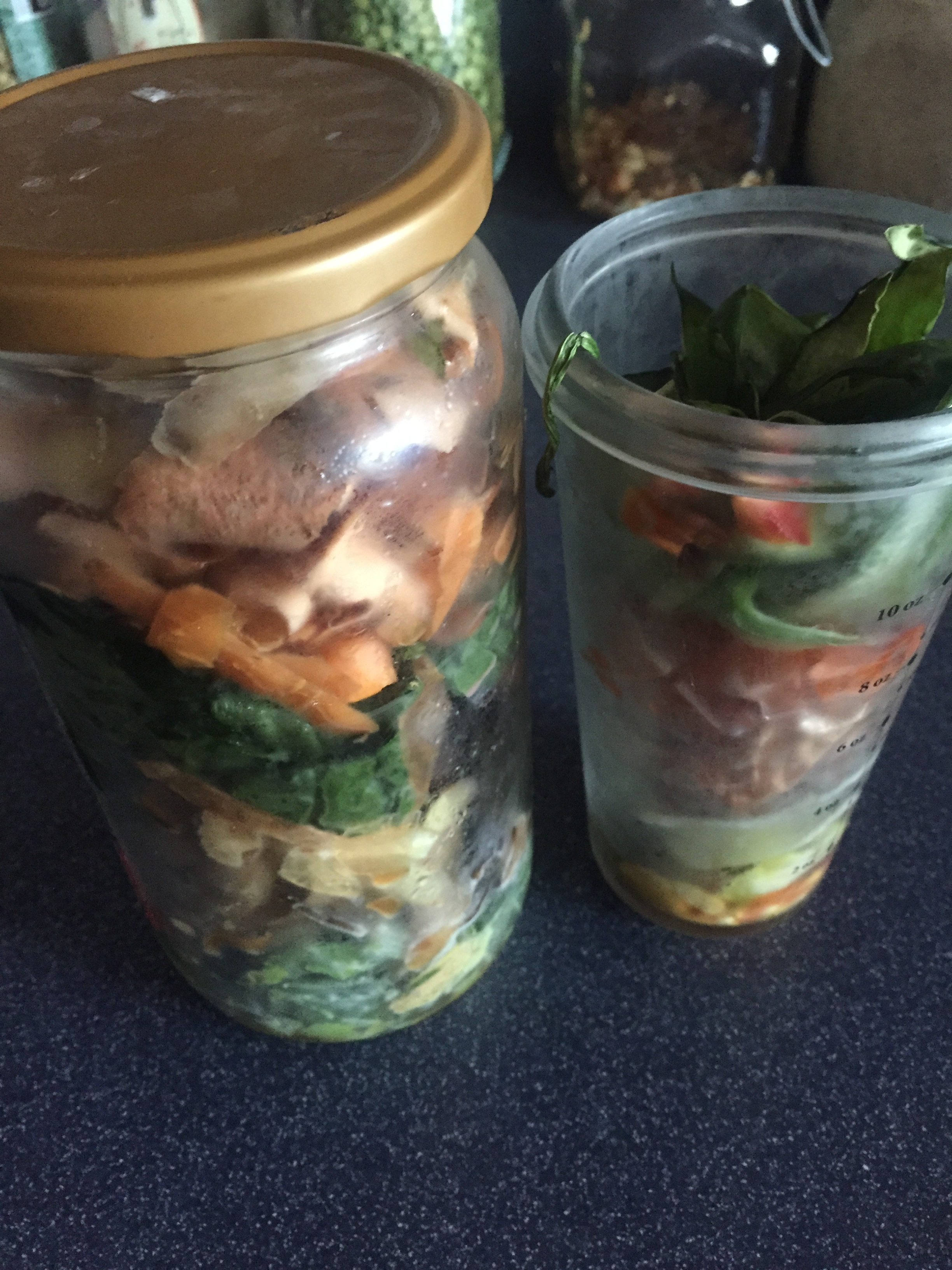 I store the kitchens scraps in glass containers in the fridge. No major issues with smell in the fridge or by the compost.