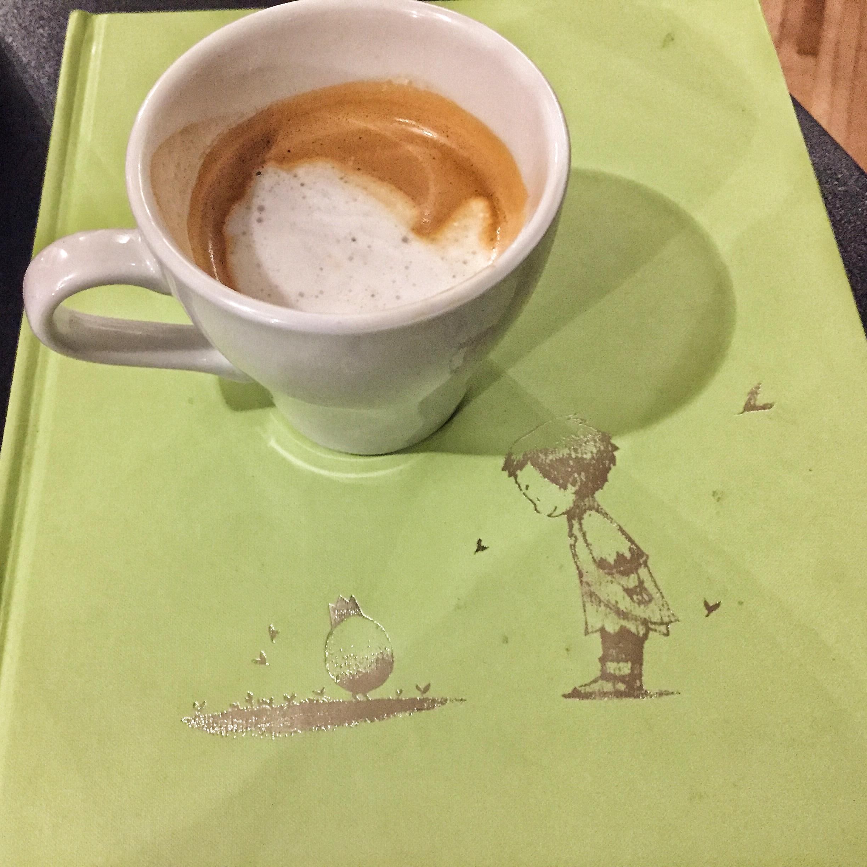 Coffee to-stay while reading Kobi Yamada's bok.