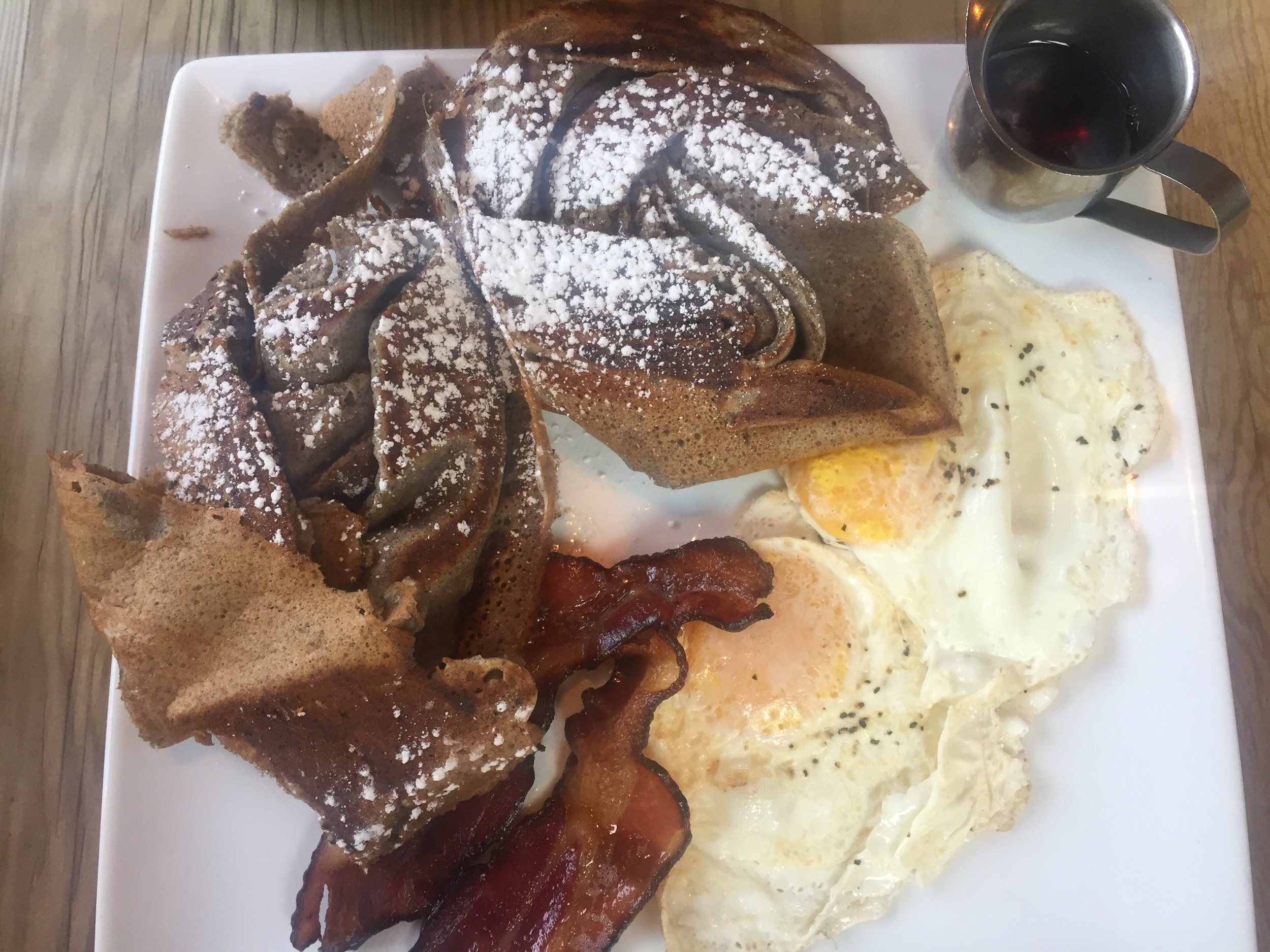 Buckwheat crepes with local bacon and eggs.