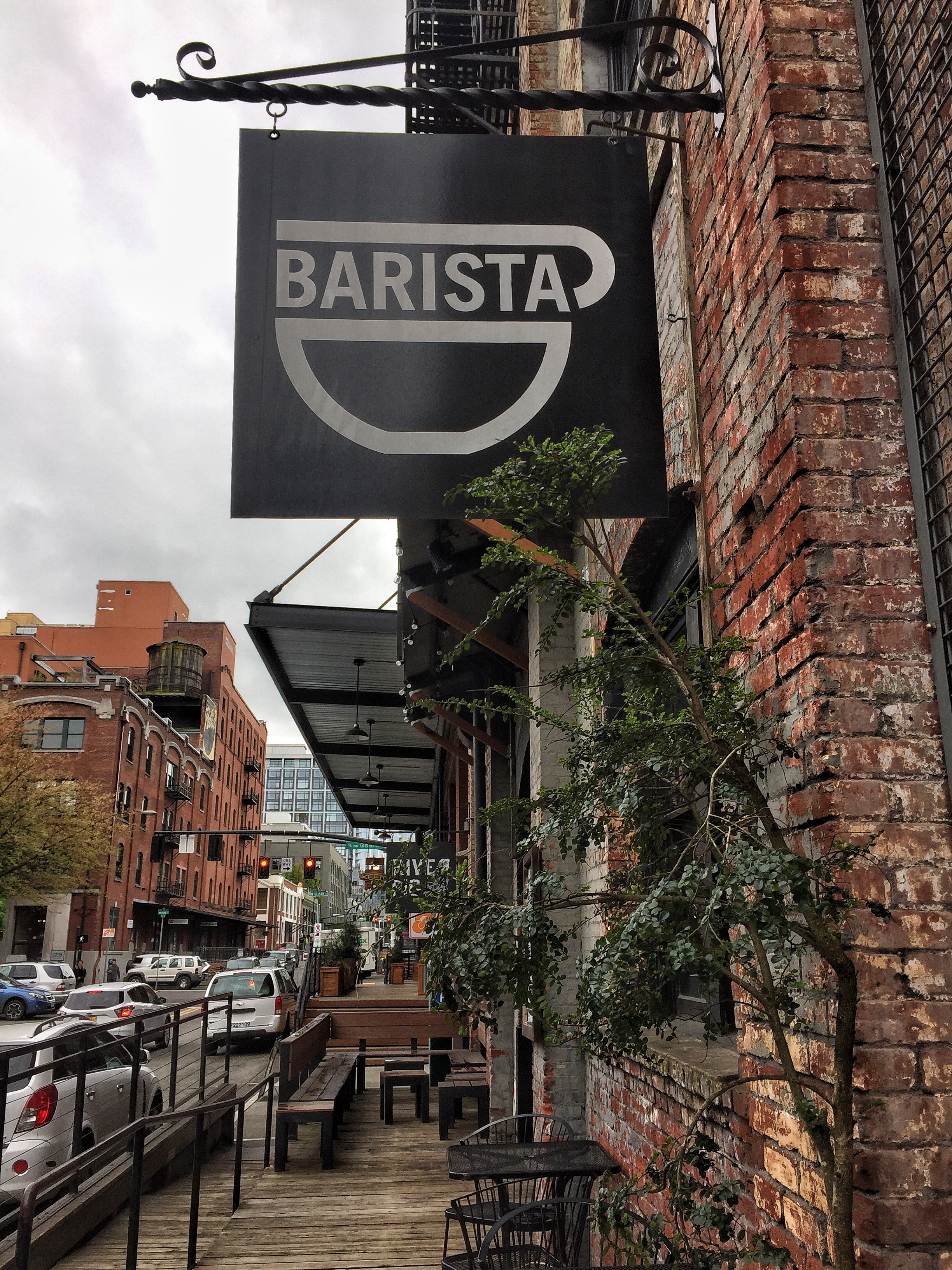 Barista Coffee Bar, where the hipster grab their coffee with their dogs. Easy place to work to with it's large windows and lots of light.