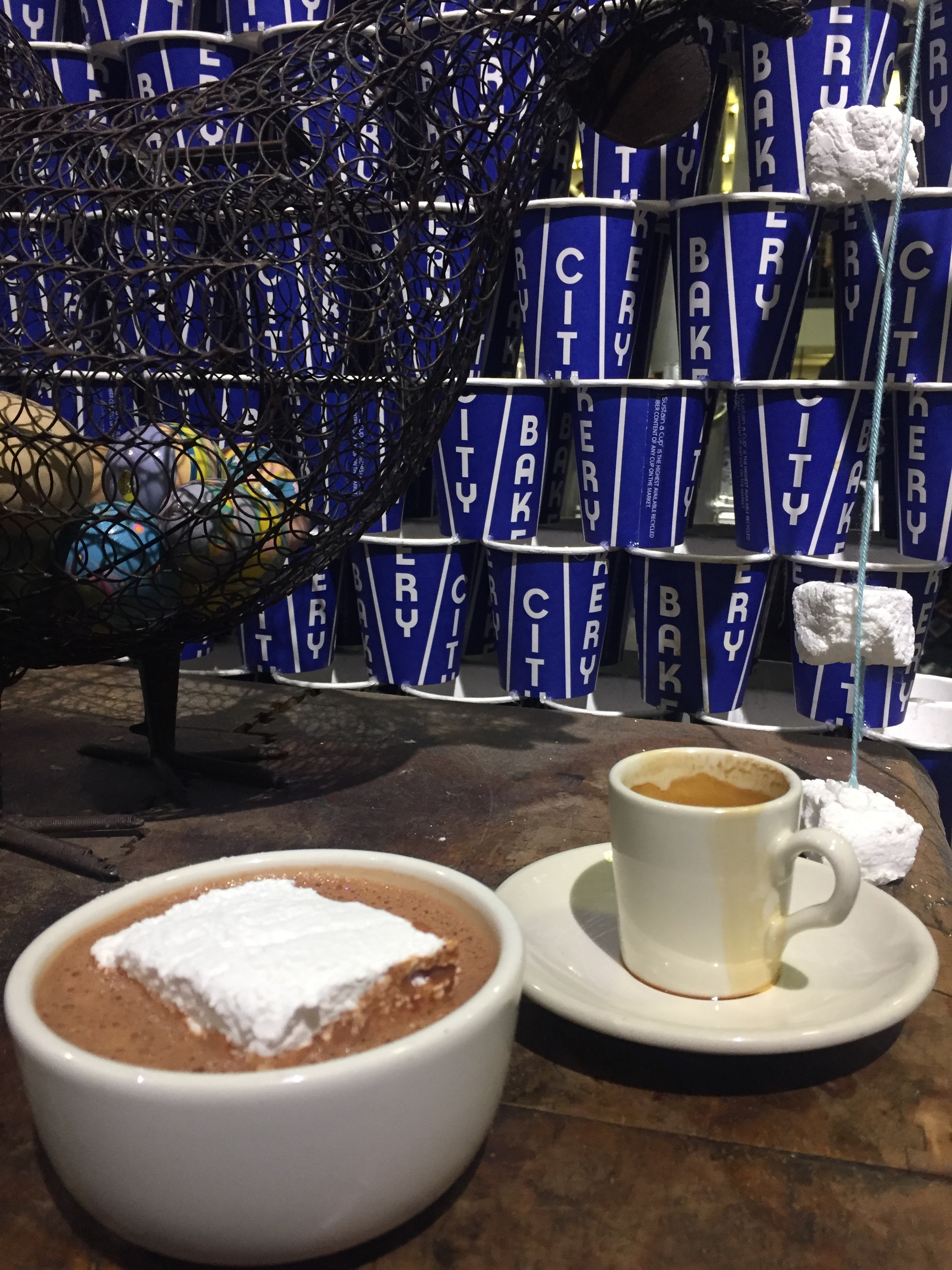 Best hot chocolate is at City Bakery and they offer to-stay mugs.