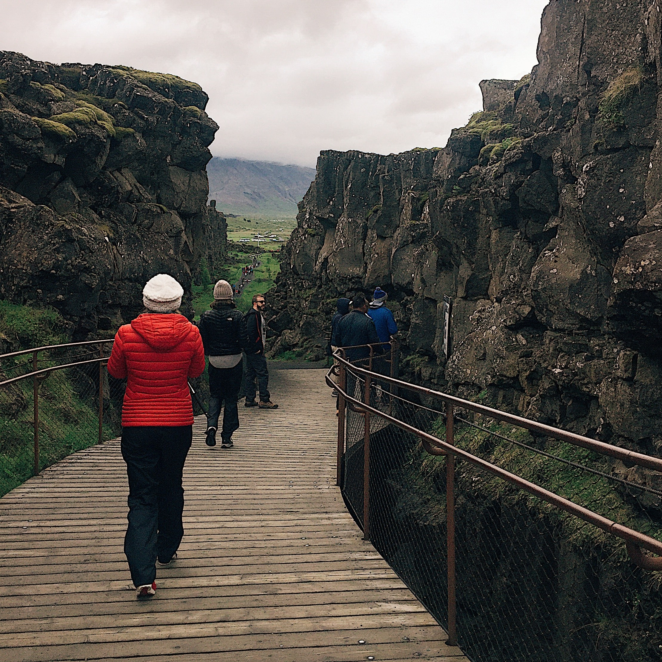 Two plates between us. Walking along the rift in the valley at Thingvellir.