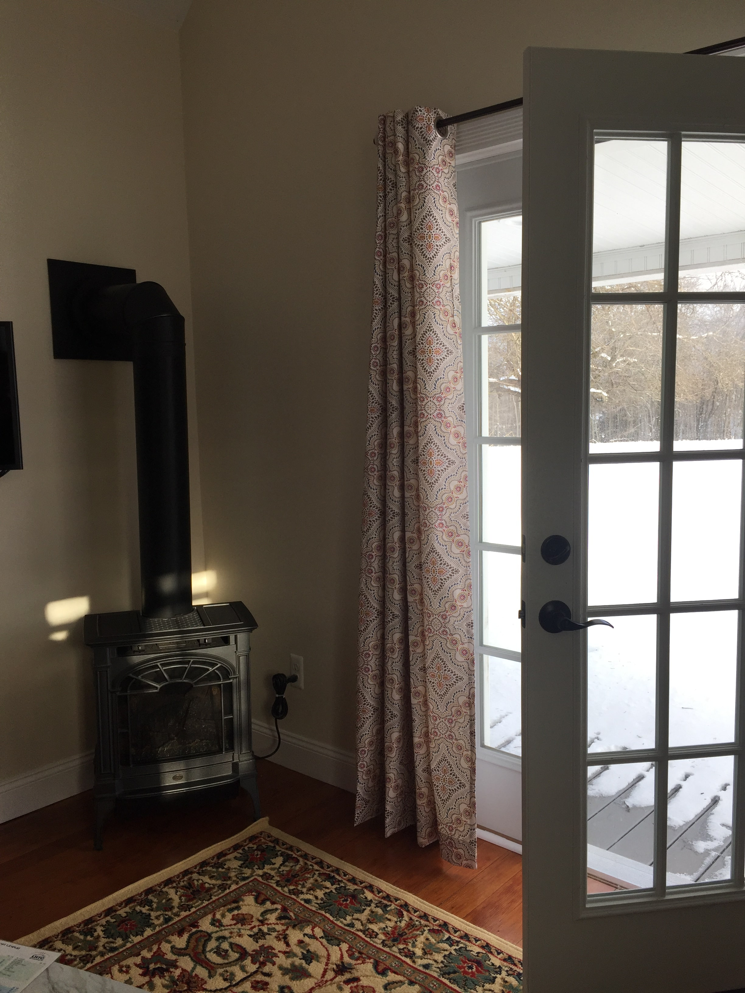 Heater and porch door overlooking farm land.