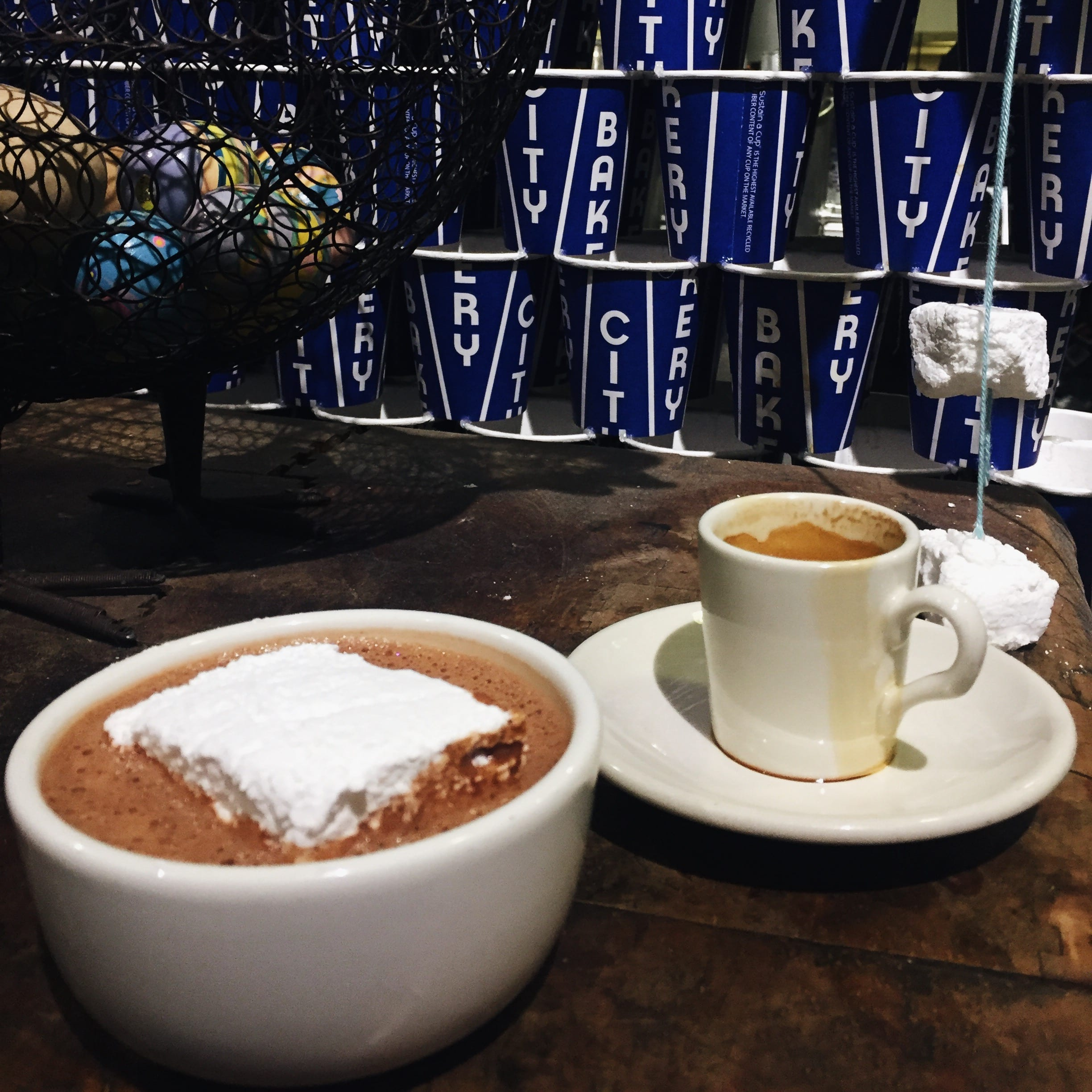 Hot chocolate and espresso at City Bakery for coffee date in mugs.