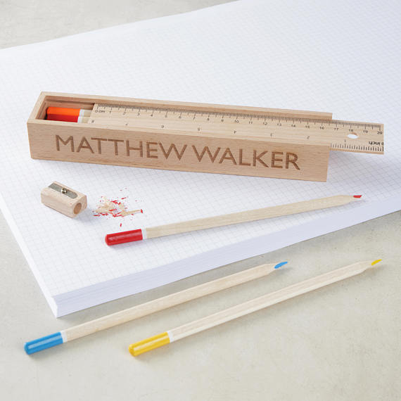 Personalized wooden pencils and case from Etsy.
