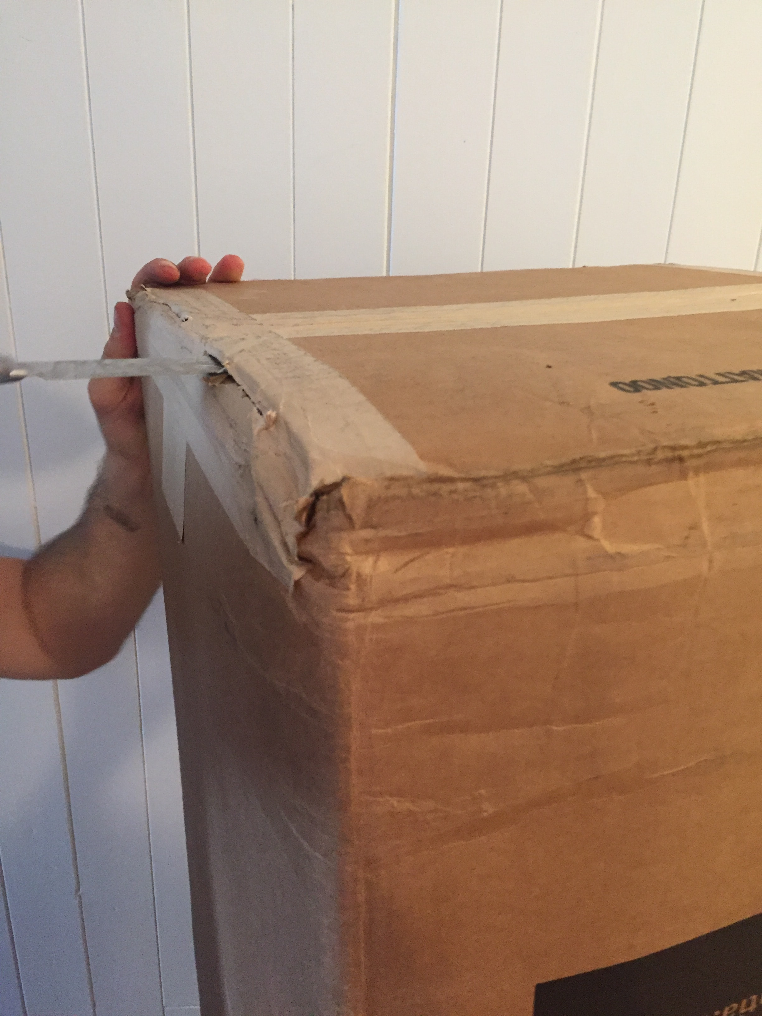 Rolled up Essentia mattress with paper tape and reinforced with heavy-duty-staples.