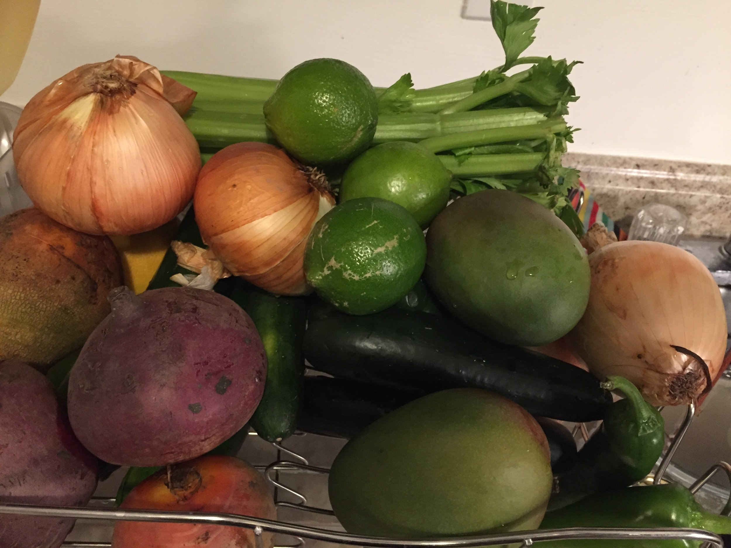 One week's worth of produce from Misfits Markets. Not pictured: Brussels sprouts. Costs around $24. Note the mango.
