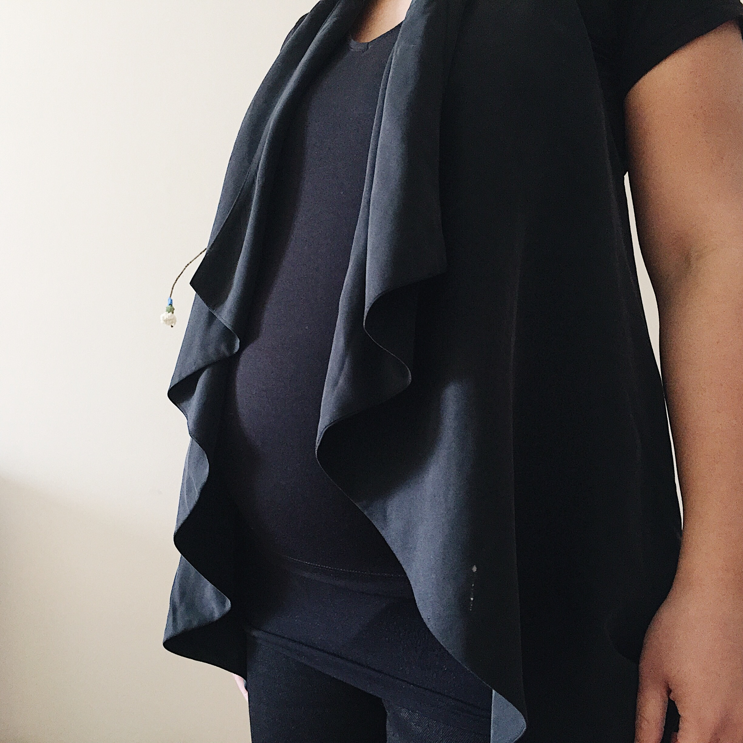Sustainable Maternity Wear - Going with a vest that I never wore, but now seems to work.
