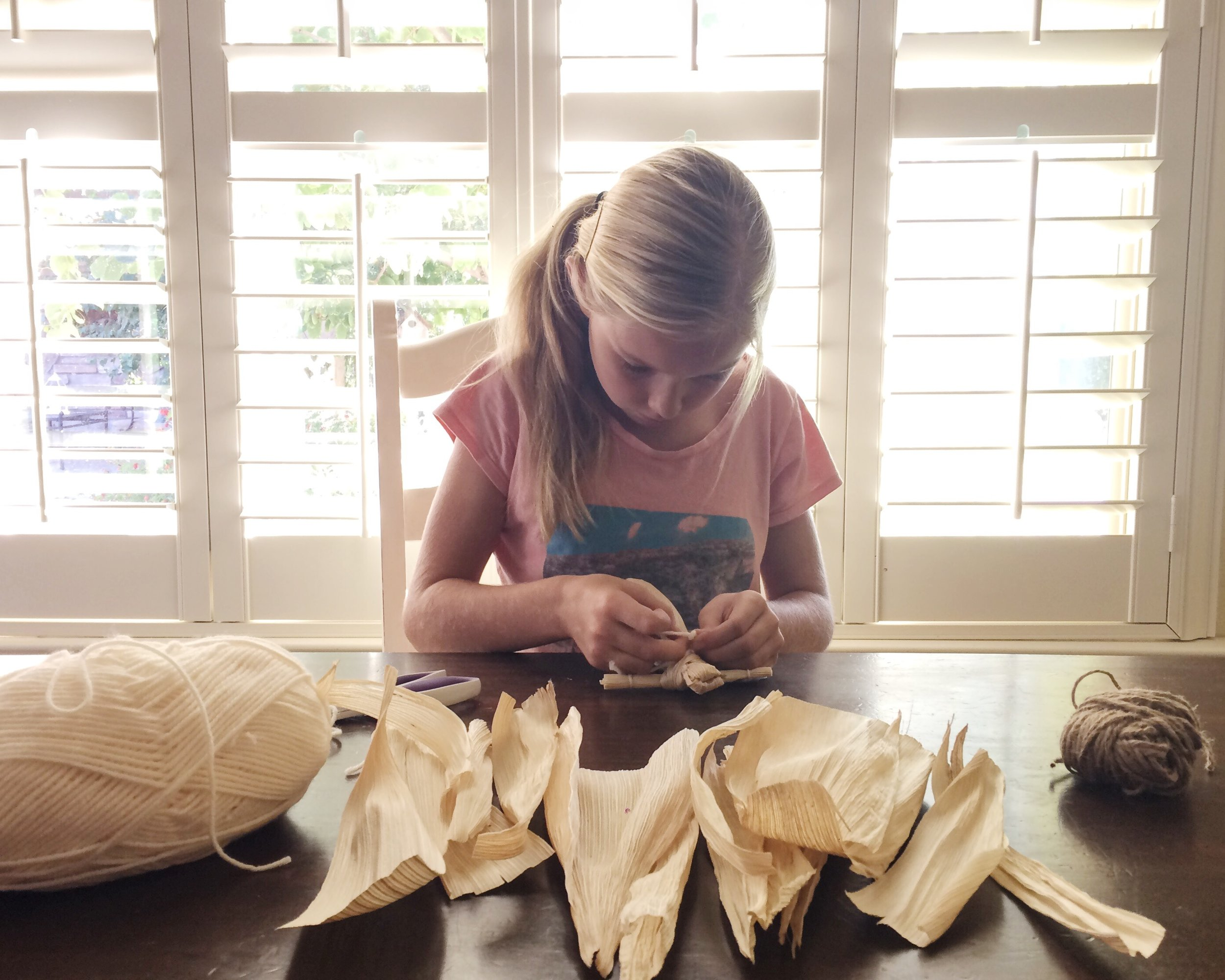 "Making corn husk dolls after reading ""Indian Captive."""