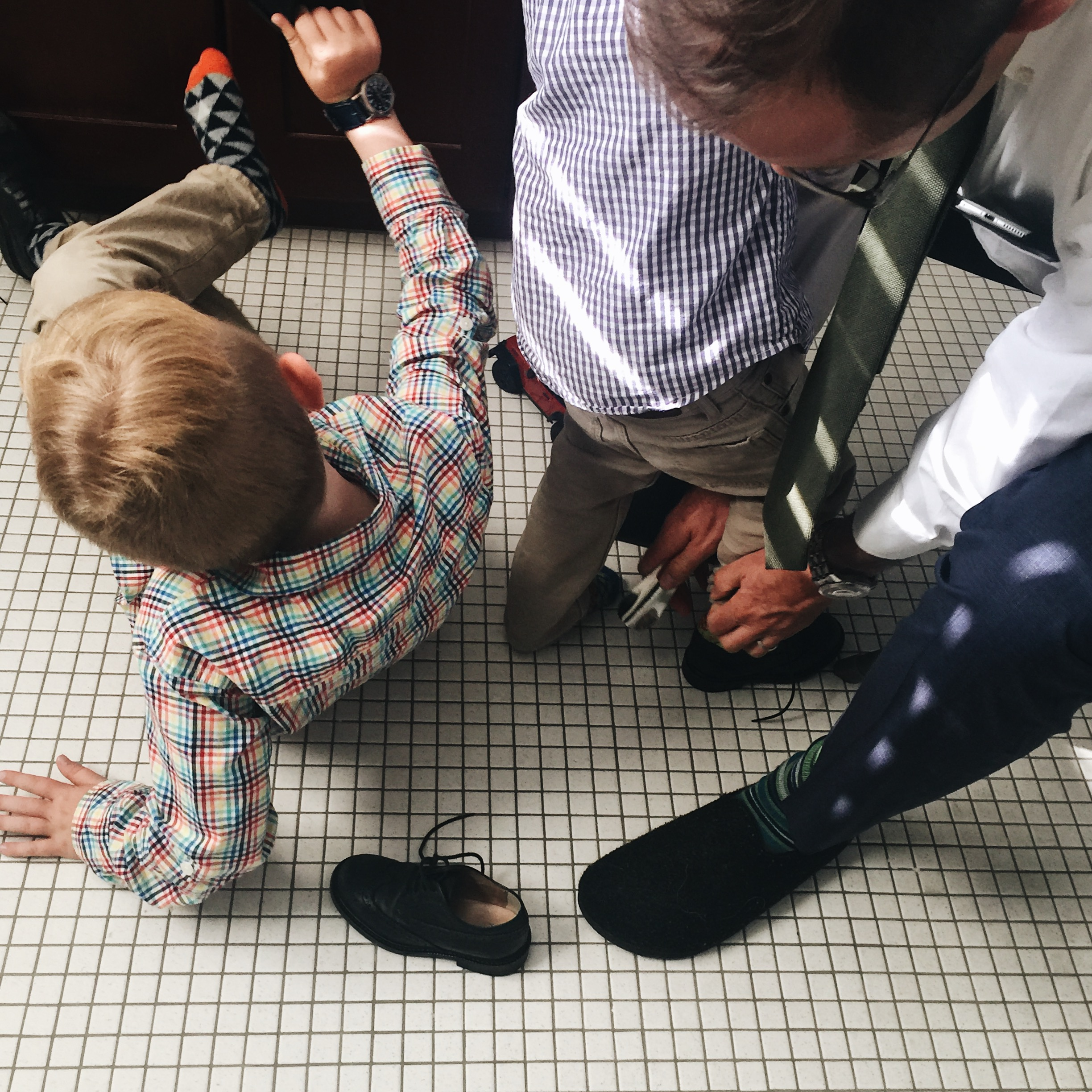 Putting on church shoes...a scene that plays out weekly at our house! The boys line up, and Dad helps them put them on and tie them...Church shoes are tough!