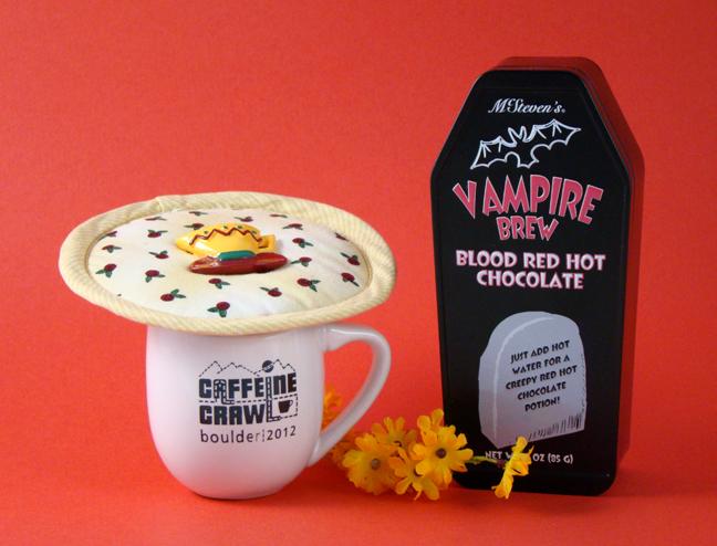 Thinsulate insulated Rosebud Rhapsody Kup Kap on small mug.