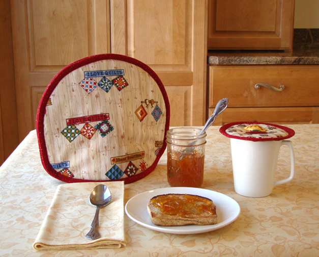 Thinsulate insulated Quilting Tea  Tabard on a teapot filled with hot tea.