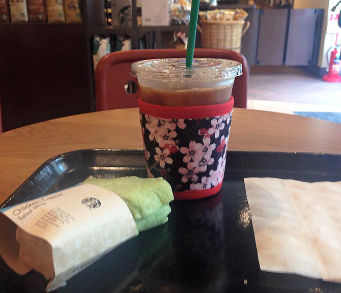 Thinsulate insulated Cherry Blossoms Kup Kollar on a 16 ounce cold take-out cup.