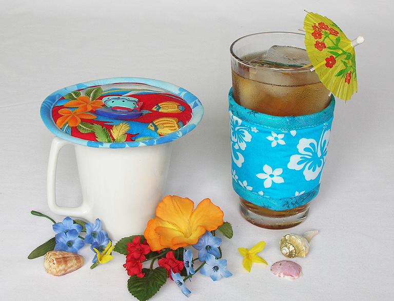 Thinsulate insulated Tropical Dolphins Kup Kap on mug and Hawaiian Teal Kup Kollar on a 16 ounce iced tea glass.