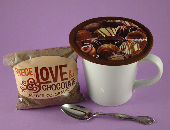 Thinsulate insulated Chocolate Truffles Kup Kap on a large ceramic mug.