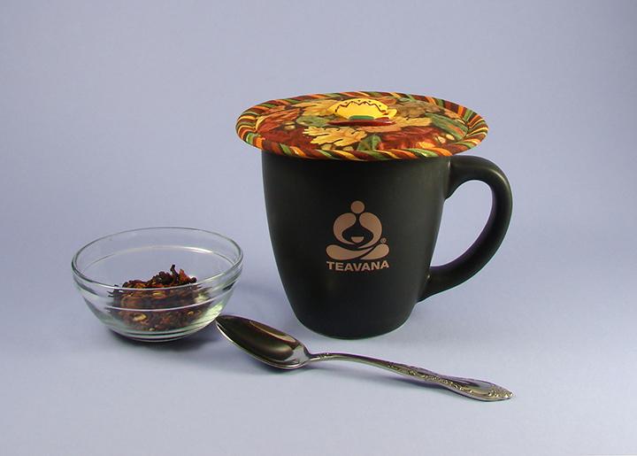 Thinsulate insulation Autumn Leaves Kup Kap on a Teavana large mug.