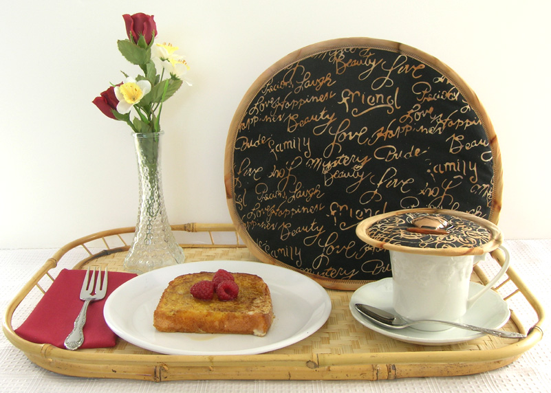 Thinsulate insulated Words of Friendship Tea Tabard on teapot and Kup Kap on cup&saucer.