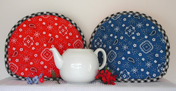 Western Tea Tabard teapot cozy covers many kinds of teapots to keep tea hot for up to an hour. All of this retailer's tea cozies and French press coffee covers have different fabrics on each side.