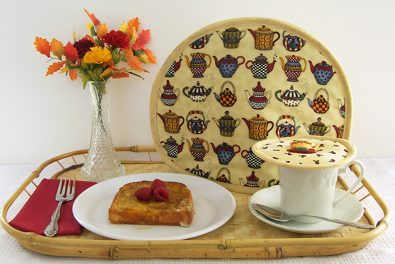 Enjoy your tea more by using Koffee Kompanions'  Tea Tabard  teapot cover. It uses two layers of heavyweight Thinsulate insulation to keep tea hotter longer. The pictured Rosebud Rhapsody  Kup Kap  (cup lid) keeps it hot after you pour.