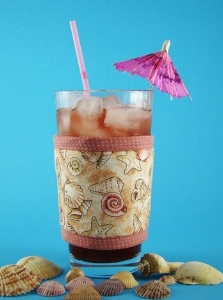 Sea shells Kup Kollar cup and glass wrap is one of  more than 30 designs  by Koffee Kompanions to keep drinks cold and hands comfortable.
