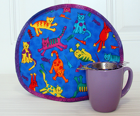Tabard Cartoon Cats lavender mug 405x491.jpg