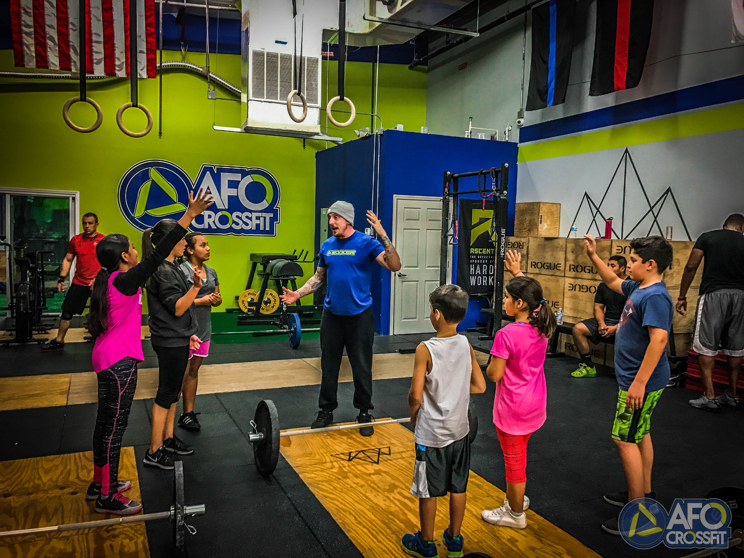 CF KIDS:  is a strength and conditioning program that is specifically designed for kids and teenagers and helps them develop a life long love of fitness. In a group setting, kids participate in fun and engaging workouts that deliver measurable results and prepare them to be well rounded athletes. The movements involved in Youth Athletics include all the things kids do when they play, pull, push, run, throw, climb, lift and jump. The program at AFO CrossFit focuses on providing an exciting and interactive environment that shows children you can have fun without an iPhone, iPad, Xbox etc.  Join Now