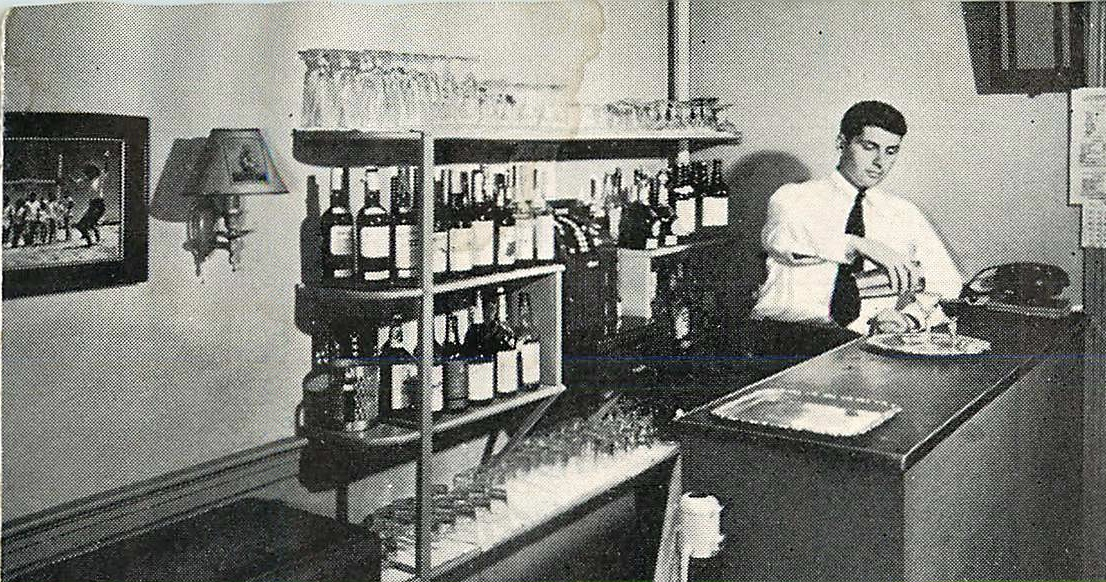 "Harold ""Budge"" Hall serving cocktails at Windswept in the 1950s"