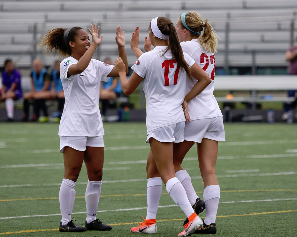 Courtney Jones (left), Mariana Speckmaier (17) and Taylor Timko (22) celebrate MCFC's second goal in their 3-1 decision over the Columbus Eagles. (JDN2 Photography)