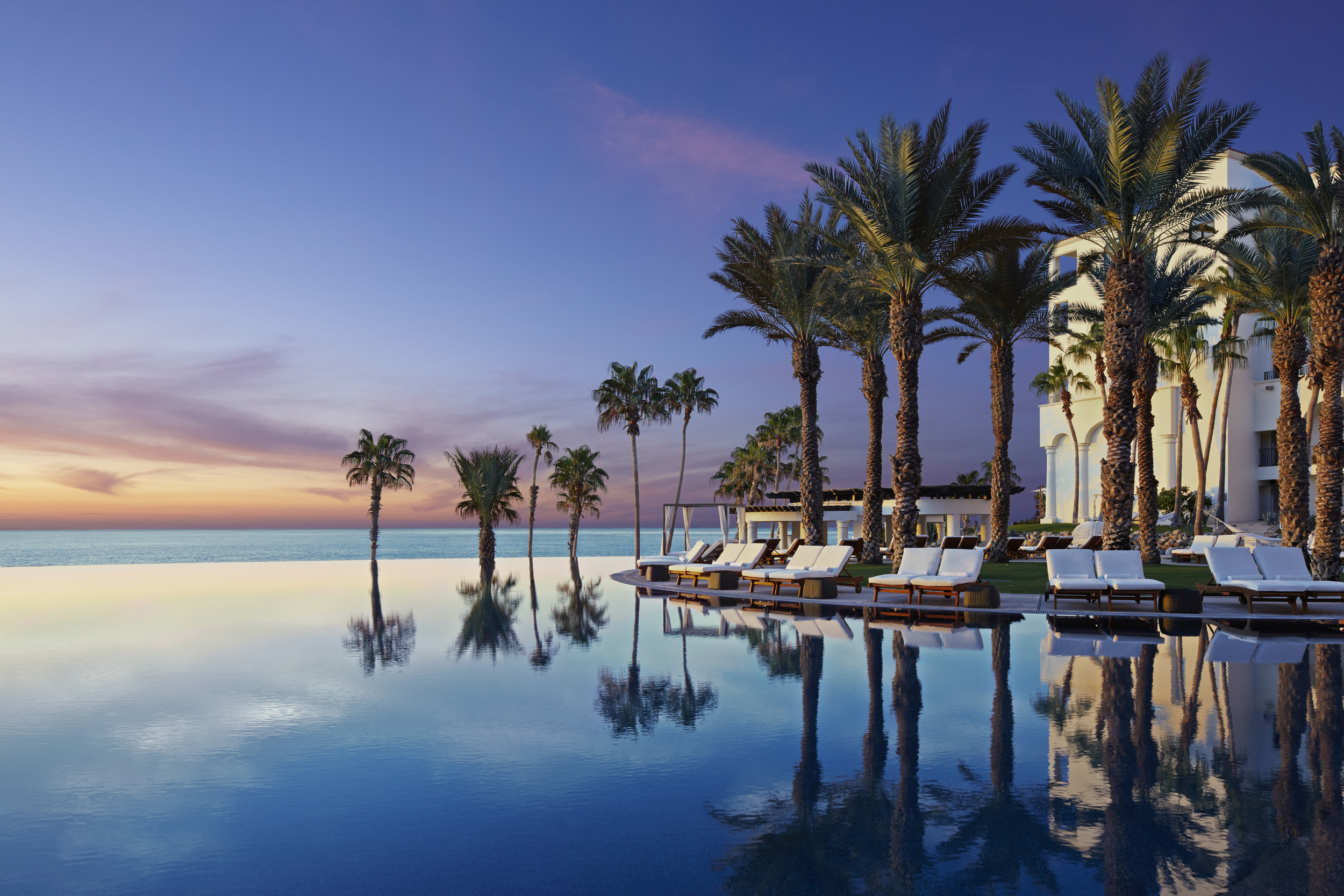 Sun setting on the infinity pool at Hilton Los Cabos Beach & Golf Resort