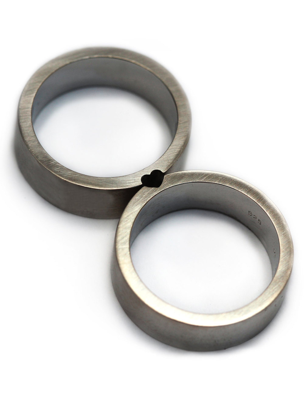 Interlocking - Well, if you are gonna tie the knot, why not make sure that your rings have an element of connectivity, too!