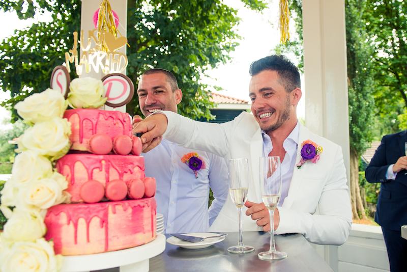 same-sex-wedding-cutting-gay-couple-cutting-wedding-cake-.jpg