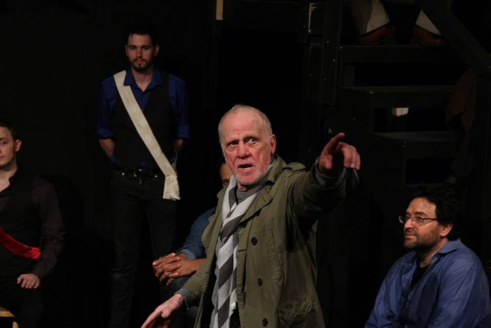 The Chorus Leading the Company - Leon Russom as the Chorus; photo by Rob Cunliffe